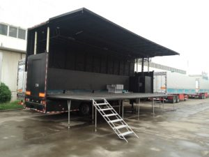 Easy folding stage on trailer
