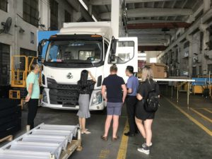 Visitors come to Siwun to talk details about advertising truck