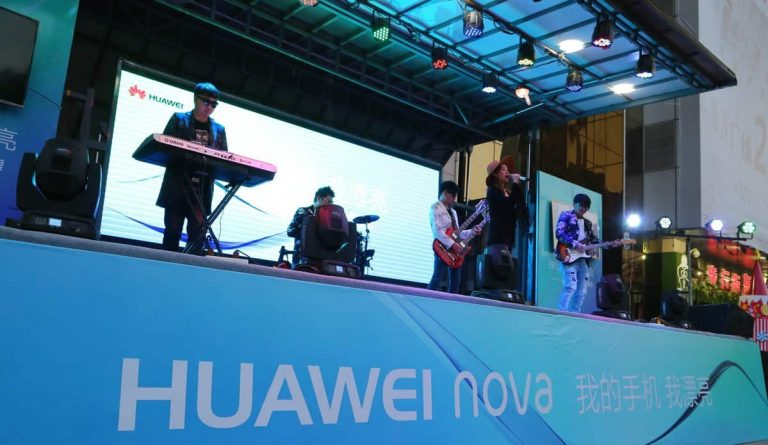 Band performance at night on Huawei truck stage